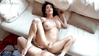 Sensual busty brunette opens her wet pussy