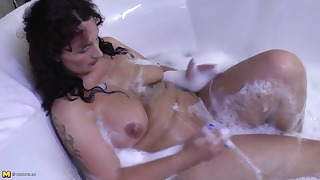 Stunning busty soapy mom shows her ass