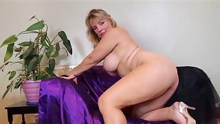 Sensual mom in high heels plays on cam