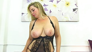 Playful mom with big boobs poses hot