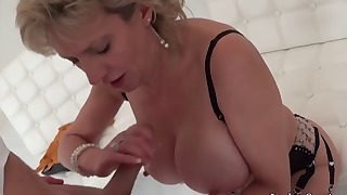 Good-looking mommy is sucking with love