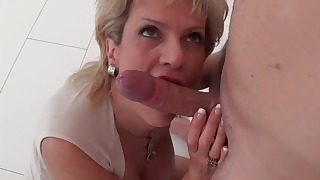 Sensual mommy is sucking a long hard penis