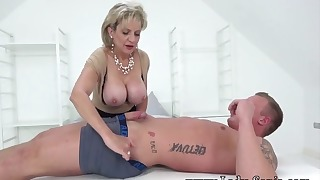 Busty mom is sucking a nice big boner