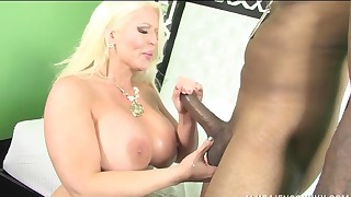 Sensual mom is sucking a big black dick
