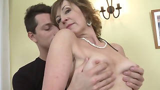 Awesome mom is blowing a nice son dick