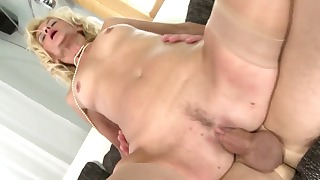 Stunning blonde mom blows son on the sofa