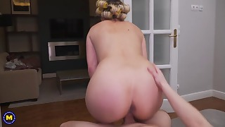 Glamorous blonde mom rides on a pretty big cock