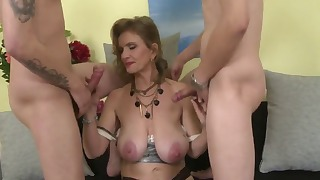 Two young men fuck with a slutty MILF