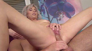 Sensual blonde mom with small tits sucks a hard dick