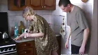 Nice russian mom and boy fuck in the kitchen